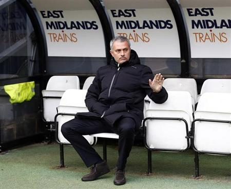 Chelsea manager Jose Mourinho gestures on the bench during their FA Cup soccer match against Derby County at the iPro Stadium in Derby
