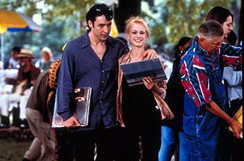 John Cusack (left) as Rob Gordon, owner of a semi-failing record store in Chicago. When his long-time girlfriend Laura ( Iben Hjejle , right) eventually walks out on him, he examines his failed attempts at romance and happiness in Touchstone's High Fidelity