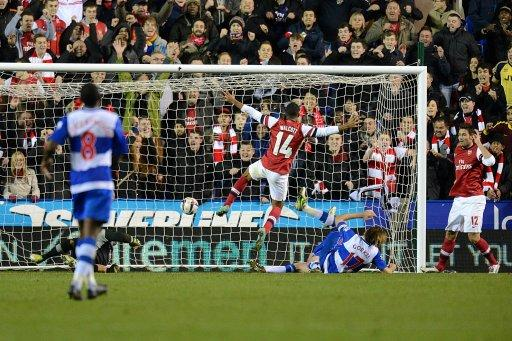 Theo Walcott, centre, scores Arsenal's sixth to round off his hat-trick