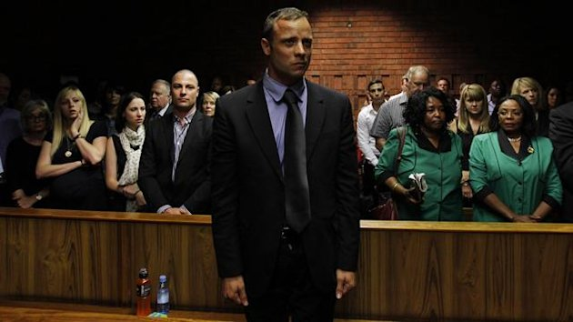 """Blade Runner"" Oscar Pistorius awaits the start of court proceedings in the Pretoria Magistrates court (Reuters)"