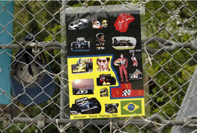 Pictures of Formula One Brazilian driver Ayrton Senna are seen on a fence at the site where Senna died at the race track in Imola