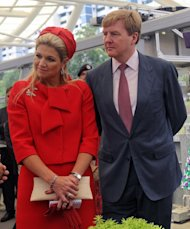 Prince Willem Alexander (R) and Princess Maxima (L) of the Netherlands are pictured in Singapore on January 25, 2013. The prince will become the first Dutch king since Willem III, who reigned until his death in 1890