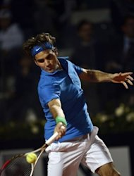 Swiss Roger Federer returns the ball to Italian Andreas Seppi during the Italian Open Tennis Tournament in Rome's Foro Italico. Federer won 6-1, 6-2