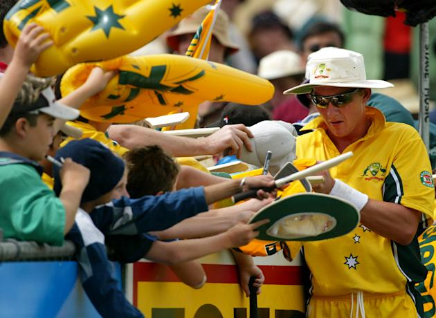 Brett Lee of Australia signs autographs for fans