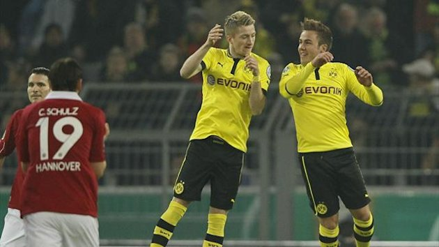 Mario Goetze (R) and Marco Reus of Borussia Dortmund celebrate Goetze's goal against Hanover 96 during their German DFB Cup match