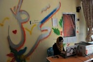 Sahar Gul's Netcafe manager Tooba Ahmadyar uses her computer at Kabul's Young Women For Change, Afghanistan's first women-only Internet cafe. Ten years after the fall of the Taliban, the use of social media in Afghanistan is booming as people rush to get their message across
