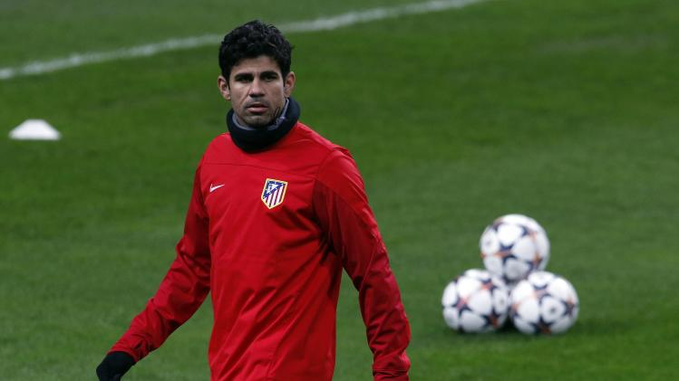 Atletico Madrid's Diego Costa attends a training session at the San Siro stadium in Milan
