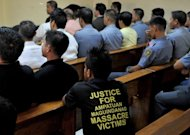 A man wears a protest T-shirt during the ongoing trial in Manila of the Ampatuans, a political clan accused of masterminding the country's worst massacre. Hearings are held just once a week and lawyers expect proceedings to drag on for years or even decades in the Philippines' backlogged justice system. Prosecutors have complained of delaying tactics by the defence