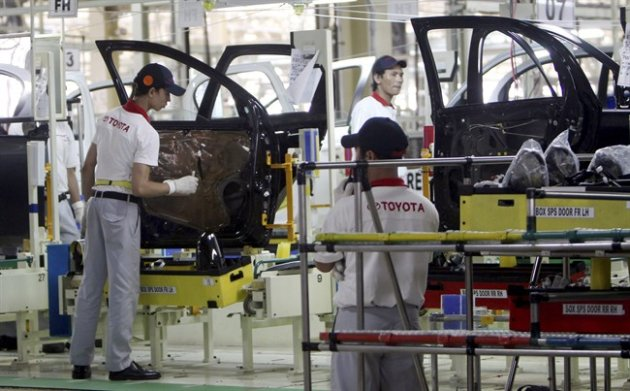 In this March 15, 2013 photo, workers assemble cars at the new Toyota plant in Indonesia (AP)