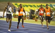 Jamaican sprinters Yohan Blake (R) and Usain Bolt (L) race for the finish during the men's 200m final of the Jamaican Olympic Athletic Trials at the National Stadium in Kingston, July 01, 2012. Blake stopped the clock at 19.80 sec
