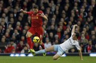 Liverpool's Steven Gerrard (L) challenges West Ham United's Mark Noble during their English Premier League soccer match at Anfield in Liverpool, northern England December 7, 2013. REUTERS/Phil Noble