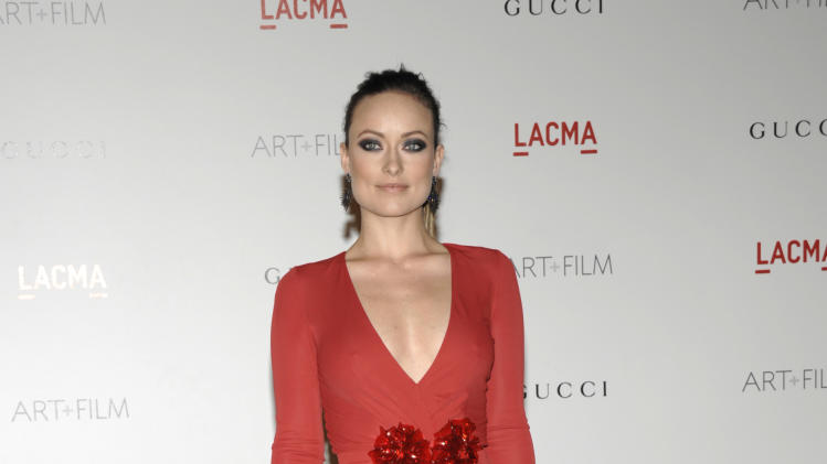 Actress Olivia Wilde arrives at the inaugural LACMA Art + Film Gala in Los Angeles on Saturday, Nov. 5, 2011. (AP Photo/Dan Steinberg)
