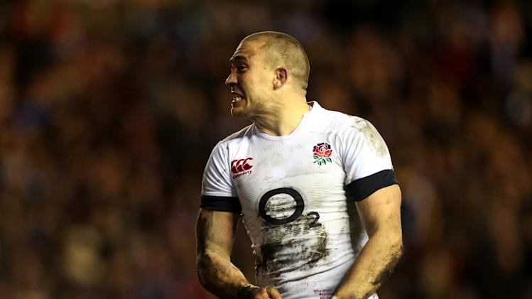England's Mike Brown celebrates after scoring a try during their Six Nations rugby union international match against Scotland at Murrayfield, Edinburgh, Scotland, Saturday Feb. 8, 2014. (AP Photo/Scott Heppell)