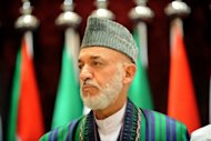 Afghan President Hamid Karzai (pictured in August) has postponed a visit to Norway fearing a violent backlash at home over an anti-Islam film that sparked riots killing the US ambassador in Libya, according to officials