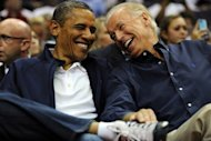 US President Barack Obama (L) share a laugh with Vice President Joe Biden as the US national basketball team plays Brazil on July 16. Obama got a bird's-eye view of the current USA national team, sitting courtside at the Verizon Center arena with his family and Vice President Joe Biden
