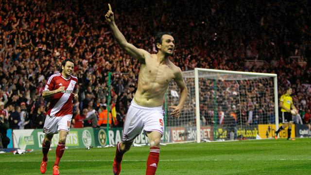 Middlesbrough's Kike celebrates with Middlesbrough's Lee Tomlin