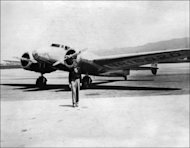 American aviator Amelia Earhart in front of her plane. The leader of a south Pacific expedition to solve a 75-year-old mystery over Earhart's disappearance vowed to leave no stone unturned Tuesday, shortly before setting sail from Hawaii