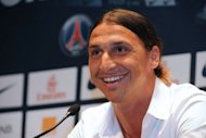 Paris Saint-Germain (PSG) football club's newly recruited Swedish striker Zlatan Ibrahimovic smiles during a press conference at the Parc des Princes on July 18 in Paris