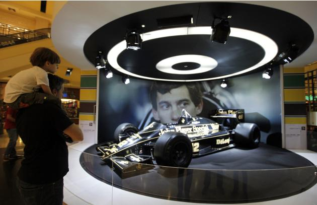 Visitors look at the Ayrton Senna John Player Special F1 car during an exhibition to mark the 20th anniversary of the death of Brazilian triple Formula One champion Ayrton Senna in Sao Paulo