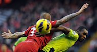 Aston Villa's forward Christian Benteke (R) and Liverpool's defender Martin Skrtel compete for the ball during the English Premier League football match at Anfield in Liverpool, north-west England on December 15, 2012