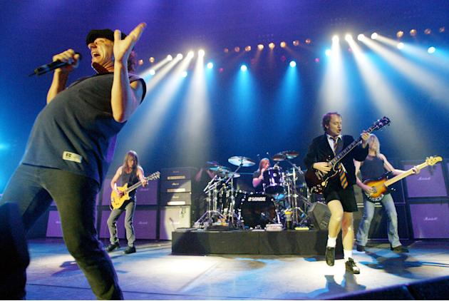 FILE - This June 17, 2003 file photo shows British rock band AC/DC, from left, Brian Johnson, Malcolm Young, Phil Rudd, Angus Young, and Cliff Williams performing on stage during a concert in Munich,