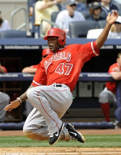 Wilson and Pujols team up, Angels stop Yankees 7-1