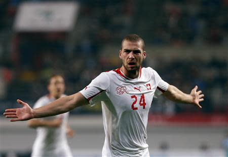 Switzerland's Pajtim Kasami celebrates after scoring a goal against South Korea during their friendly soccer match in Seoul
