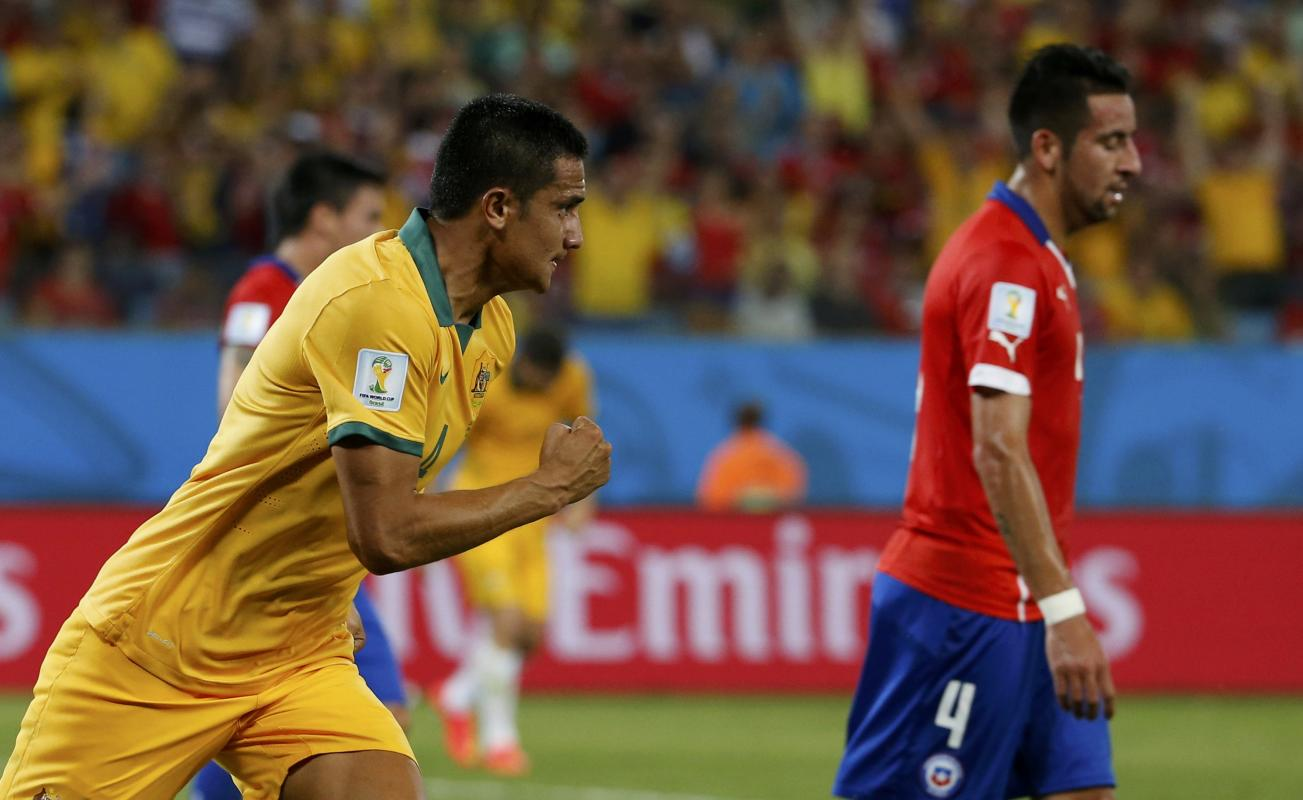Australia's Cahill celebrates after scoring a goal against Chile during their 2014 World Cup Group B soccer match at the Pantanal arena in Cuiaba