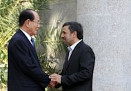 Iranian President Mahmoud Ahmadinejad (right) shakes hands with Kim Yong-Nam, North Korea's ceremonial head of state, in Tehran on September 1. Kim has vowed to strengthen ties with Iran and reaffirmed a shared hostility towards the US during a meeting with Ahmadinejad, North Korea's state media said