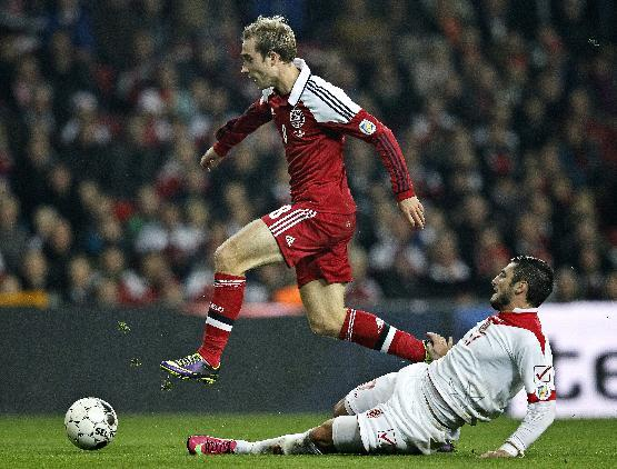 Denmark's Christian Eriksen, left, and Malta's Ryan Fenech vie for the ball during their group B World Cup qualifying soccer match in Parken, Copenhagen, Tuesday Oct. 15, 2013