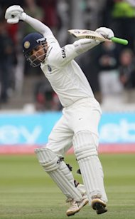 Dravid punches the air after completing his 33rd Test hundred.