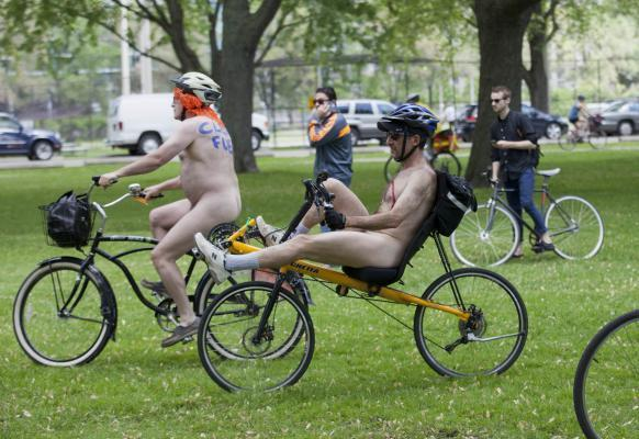 TORONTO, June 15, 2014 (Xinhua) -- Participants take part in the 2014 World Naked Bike Ride event in Toronto, Canada, June 14, 2014, to protest against oil dependency, raising awareness of cycling as