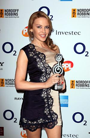 Singer Kylie Minogue seen during the Nordoff Robbins O2 Silver Clef Awards at a venue in central London, Friday, June 29, 2012. (AP Photo/Sean Dempsey/PA) UNITED KINGDOM OUT