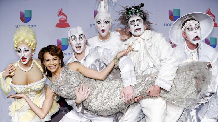 Leslie Grace, center, arrives with members of Cirque Du Soleil: Ka at the 14th Annual Latin Grammy Awards at the Mandalay Bay Hotel and Casino on Thursday, Nov. 21, 2013, in Las Vegas. (Photo by Eric Jamison/Invision/AP)