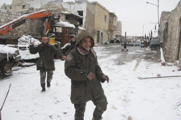 Free Syrian army fighters play with snow in Aleppo's Karm al-Jabal district