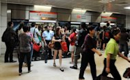 This file photo shows commuters on an SMRT train arriving at Bishan train station interchange in Singapore, in April. Singapore's first strike in 26 years petered out with most of the Chinese bus drivers who had stopped working to demand higher pay reporting for duty