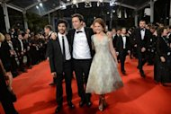 "French actor Tahar Rahim (L), French actress Emilie Dequenne and Belgian director Joachim Lafosse arrive for the screening of ""The Angel's Share"" presented in competion at the 65th Cannes film festival"