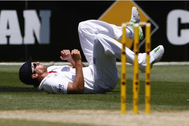 England's captain Cook reacts after dropping a catch played by Australia's Rogers during the fourth Ashes cricket test in Melbourne