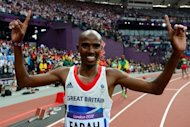 Britain's Mo Farah celebrates after winning the gold medal in the men's 5000m final at the athletics event of the London 2012 Olympic Games
