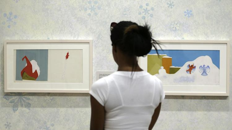 In this Friday, July 19, 2013 photo, a visitor views illustrations at The Snowy Day and The Art Of Ezra Jack Keats exhibition at the National Museum of American Jewish History, in Philadelphia. The exhibit opened July 19. (AP Photo/Matt Rourke)