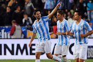 Malaga's midfielder Isco (L) celebrates after scoring during their Spanish league football match against Real Madrid at La Rosaleda stadium in Malaga on December 22, 2012. Real Madrid coach Jose Mourinho was under renewed pressure on Saturday after his team lost 3-2 at Malaga, a defeat which left the champions 16 points behind leaders Barcelona