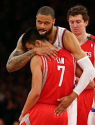 Tyson Chandler of the New York Knicks embraces former teammate Jeremy Lin of the Houston Rockets before the opening tipoff on December 17, 2012 at Madison Square Garden in New York City. Lin is one of the few Asian Americans in NBA history, and the first American of Taiwanese descent to play in the league