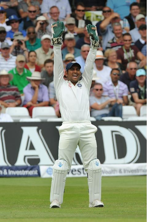 India captain M S Dhoni celebrates after England's Gary Ballance is out LBW for 71 runs by India's Ishant Sharma during day three of the first Test between England and India at Trent Bridge cr
