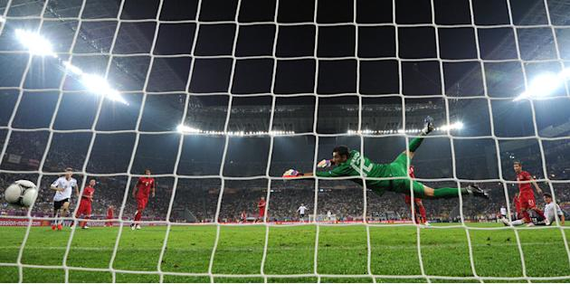 TOPSHOTS Portugal's Goalkeeper Rui Patricio Fails To Stop A Goal Scored By German Forward Mario Gomez (R)  AFP/Getty Images