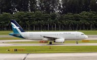 A SilkAir plane prepares for take-off at Changi International Airport in Singapore, 2003. SilkAir, the regional wing of Singapore Airlines, said it has signed a letter of intent to buy up to 68 new Boeing planes