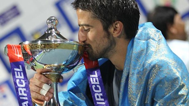 Serbian tennis player Janko Tipsarevic kisses the Chennai Open Trophy after defeating Spanish opponent Roberto Bautista-Agut during their final match at the ATP Chennai Open 2013 in Chennai on January 6, 2013 (AFP)