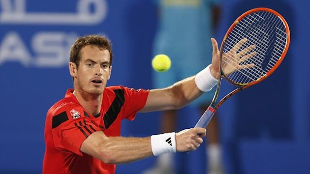 Andy Murray of Britain hits a return to Jo-Wilfried Tsonga of France during the quarter-final tennis match of the Mubadala World Tennis Championship in Abu Dhabi December 26, 2013 (Reuters)