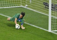 Gianluigi Buffon saves Ashley Cole's attempt in the penalty shootout between England and Italy after their goalless Euro 2012 quarter-final. Former England striker Michael Owen led calls for an overhaul of the country's coaching on Monday after another major tournament campaign ended in disappointment