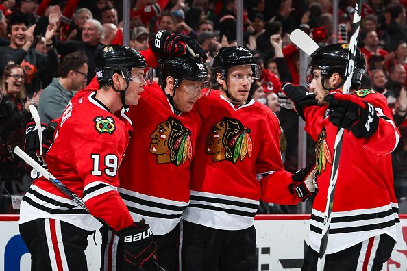 CHICAGO, IL - NOVEMBER 13: (L-R) Jonathan Toews #19, Marian Hossa #81, Richard Panik #14 and Nick Schmaltz #8 of the Chicago Blackhawks celebrate after Hossa scored against the Montreal Canadiens in the second period at the United Center on November 13, 2016 in Chicago, Illinois. (Photo by Chase Agnello-Dean/NHLI via Getty Images)