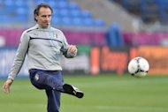 Italian head coach Cesare Prandelli kicks the ball during a training session of the Italian team at the municipal stadium in Poznan on the eve of the Group C match Italy vs Ireland during the Euro 2012 football championships